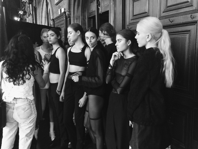 Casting director talking with models before the show